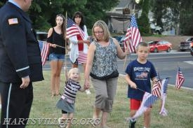 Families retrieving the flags