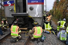 Warminster Firefighters using air bags to lift the train and gain access to a patient under the train.
