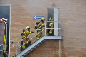 Hartsville Firefighters make entry into a second floor area.