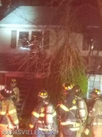 Crews work to open windows and ventilate heat and smoke.