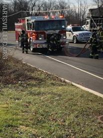 Crews from the Engine stretch a hose to attack the fire