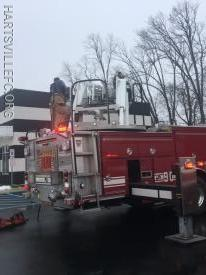 Ladder 90 placed the main ladder to the roof to check for extension of the fire.