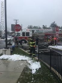 Squirt 93 cleans up a hose line after the fire
